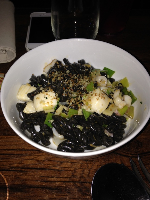 Casarecce nero, squid ink pasta with scallops, calamari, calabrian chili, snap peas